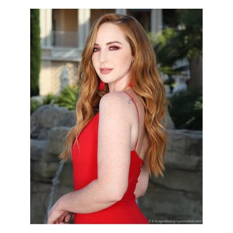 Alluring actress Camryn Grimes posing for the camera