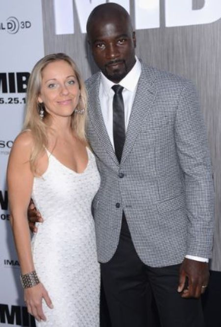 Iva Colter posing with her husband on a event